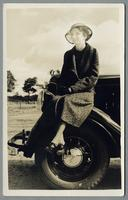 "Portrait of Angie Bowers on Walter Scotts Model ""T"" Ford, House of David, Benton Harbor, Michigan"