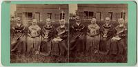 Four Shaker women posed seated outdoors