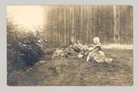 Shaker sister with turkeys and chicks, Shaker Village, Canterbury, New Hampshire [front]