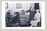Photograph of Shaker sisters: [L - R: Bertha Lindsay, Miriam Wall (standing), and Lillian Phelps] [front]