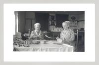 Shaker women making sewing boxes, Canterbury, New Hampshire [L - R: Bertha Lindsay and Lillian Phelps making sewing boxes] [front]