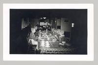 Shaker sisters sitting at a dining table in the dining room of the Church Family Dwelling, Shaker Village, Canterbury, New Hampshire