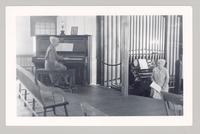 Lillian Phelps seated at the pipe organ and Aida Elam seated at the piano, Chapel of the Church Family Dwelling, Shaker Village, Canterbury, New Hampshire