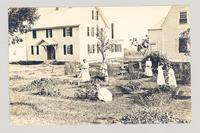 Girls tending a garden, Shaker Village, Canterbury, New Hampshire [pictured: Florence, Edna, Grace and Alice Hewitt, Leona Merrill and one unidentified girl] [front]