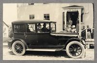 Automobile and Shaker villagers in front of Post Office, Sabbathday Lake, Maine