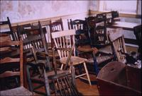 Chairs stacked in room at Snow Hill Cloister