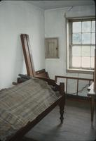 Bed frame and boards in second floor room of the Brothers' section in the nunnery house at Snow Hill Cloister