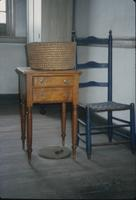 Chair, basket and table in saal at Snow Hill Cloister
