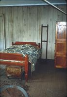 Bed and dresser in room at Snow Hill Cloister