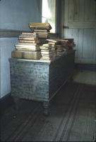 Books on chest in room at Snow Hill Cloister