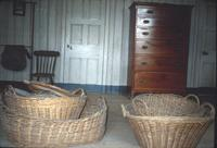 Baskets and dresser in room at Snow Hill Cloister