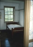Bed in second floor room of Brothers' section in nunnery house at Snow Hill Cloister