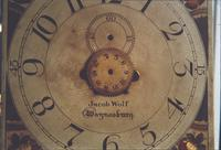 Face of Jacob Wolf grandfather clock in dining room of nunnery house at Snow Hill Cloister