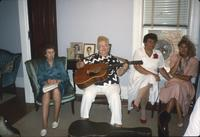 Women sitting in room with guitar at Snow Hill Cloister