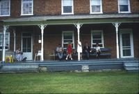 People dining on porch at Snow Hill Cloister