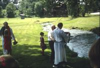 People at creek following baptism service at Snow Hill Cloister