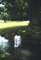 Man in creek following baptism service at Snow Hill Cloister