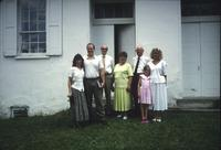 People standing in front of church at Snow Hill Cloister