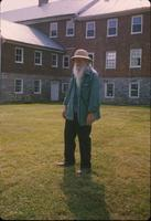 Man standing in front of nunnery house at Snow Hill Cloister