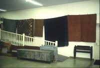 Bed boards, blankets, and chests in Horst Auction House at Ephrata, Pa.