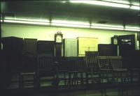 Chairs, cabinets, and grandfather clock in Horst Auction House at Ephrata, Pa.