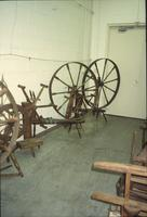 Spinning wheels in Horst Auction House at Ephrata, Pa.