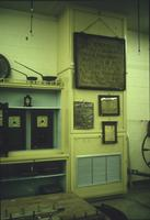 Wall hangings and clocks in Horst Auction House at Ephrata, Pa.