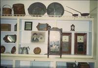 Pictures, clocks, pottery, and buckets in Horst Auction House at Ephrata, Pa.