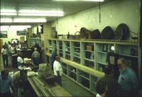 People perusing pottery in Horst Auction House at Ephrata, Pa.