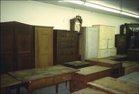 Tables, cabinets, and grandfather clocks in Horst Auction House at Ephrata, Pa.