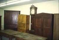 Tables, cabinets, and grandfather clock in Horst Auction House at Ephrata, Pa.