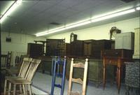 hairs, tables, chests, cabinets, and grandfather clocks in Horst Auction House at Ephrata, Pa.