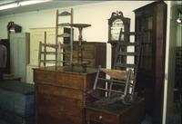 Chairs, chests, cabinets, and grandfather clocks in Horst Auction House at Ephrata, Pa.