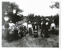Group of school boys in the apple orchard [front]