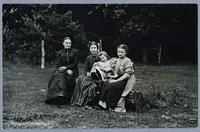 Group of three women and two children in Homestead timber, ca. 1915