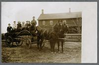 Lumber wagon with the Selzer Kitchen House in background, ca. 1906 [front]