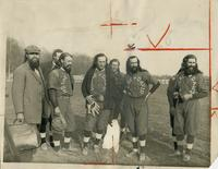 Seven members of the House of David baseball team in uniform with another member of the House of David