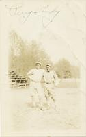 Perry and Andy posing in uniform on the baseball diamond