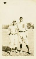 "Holman ""Pee Wee"" Bass and John ""Long John"" Tucker posing in their baseball uniforms"