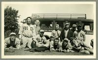 Eleven members of the House of David Central States Travelers baseball team and another man in front of a van