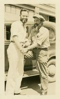"Clift and Doc smiling in front of the car named ""Hudson"""