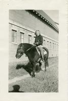 Arterene Vieritz on a horse on the House of David dairy farm