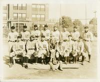 House of David baseball team in uniform posed on the bench