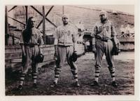 Three House of David Eastern Travelers baseball players in uniform posing on the baseball field