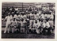City of David baseball team in uniform posed on the field with people visible in the bleachers behind them