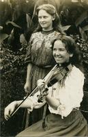 Flossie Tulk and Ethel Rosetta  in front of foliage