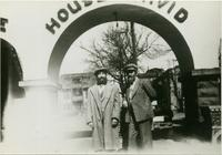 "Frye and Sam Nelson posing under ""House of David"" archway"