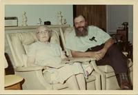 Man and woman posed in identical chairs