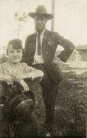 Man standing behind seated woman