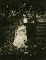 Two women posed among plants